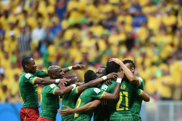 Cameroon's team celebrate after scoring a goal during the Group A football match between Cameroon and Brazil at the Mane Garr