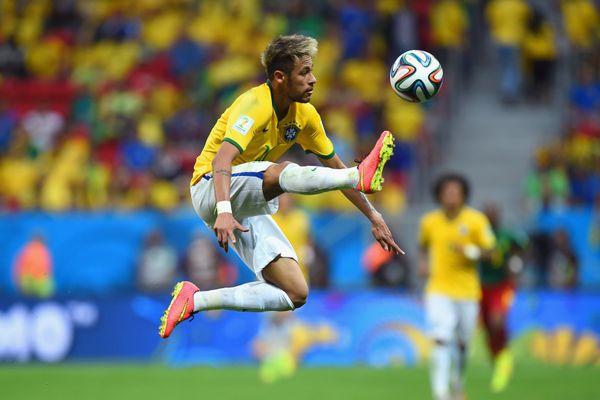 BRASILIA, BRAZIL - JUNE 23: Neymar of Brazil controls the ball during the 2014 FIFA World Cup Brazil Group A match between Ca