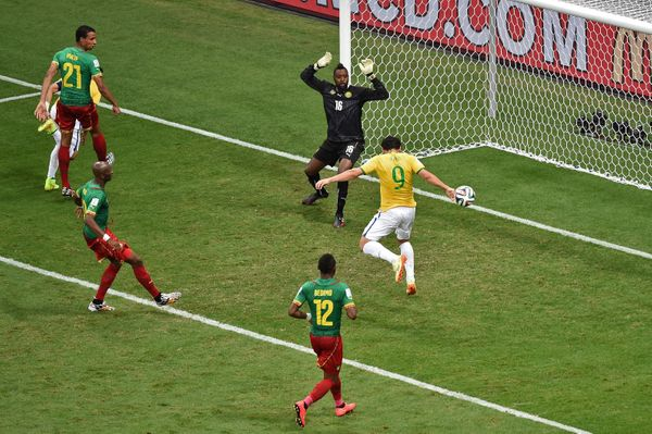 Brazil's forward Fred (9) scores a goal as Cameroon's goalkeeper Charles Itandje (16) fails to defend during the Group A foot