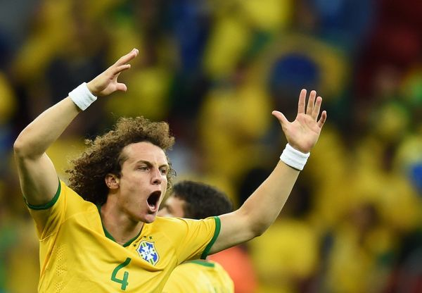 Brazil's defender David Luiz celebrates after Brazil's forward Fred (not pictured) scored during a Group A football match bet