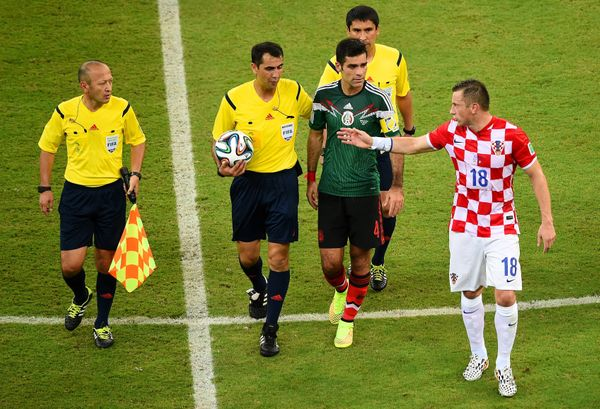 RECIFE, BRAZIL - JUNE 23:  Ivica Olic of Croatia reacts toward referee Ravshan Irmatov as they leave the pitch at half-time d