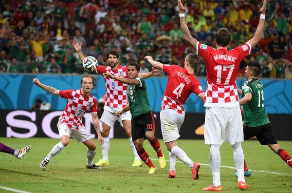 Mexico's forward Giovani Dos Santos (C) attacks the goal of Croatia during a Group A football match between Croatia and Mexic