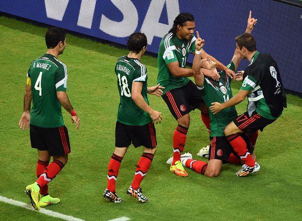 RECIFE, BRAZIL - JUNE 23:  Javier Hernandez of Mexico (center) celebrates scoring his team's third goal during the 2014 FIFA