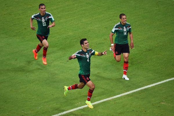 RECIFE, BRAZIL - JUNE 23:  Rafael Marquez of Mexico (center) celebrates scoring his team's first goal during the 2014 FIFA Wo