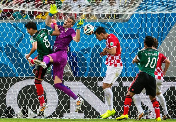 RECIFE, BRAZIL - JUNE 23:  Dejan Lovren of Croatia clears the ball off the line during the 2014 FIFA World Cup Brazil Group A