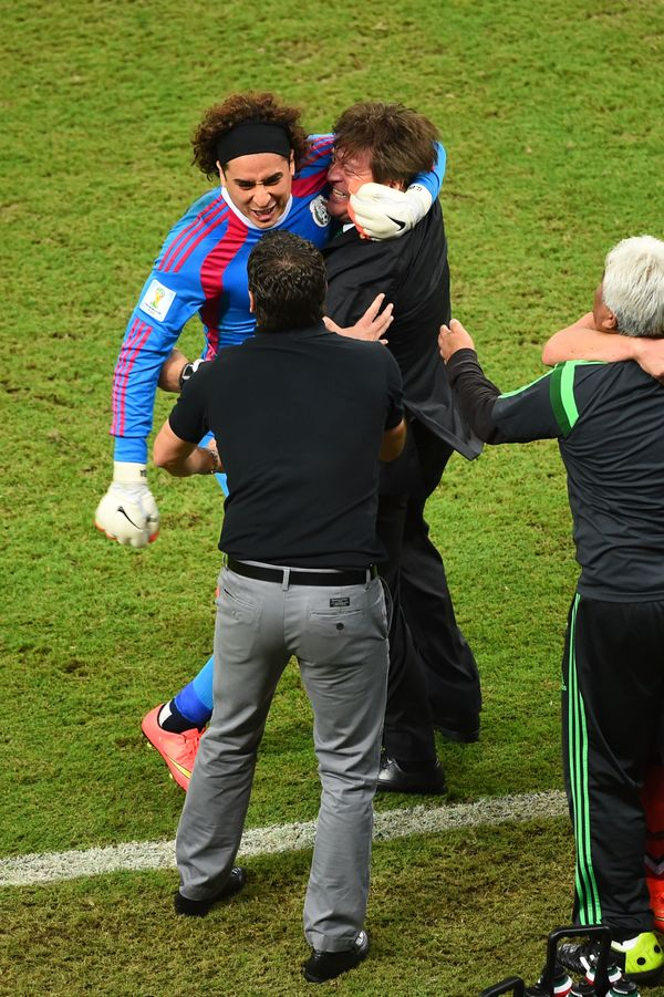 RECIFE, BRAZIL - JUNE 23:  Guillermo Ochoa of Mexico celebrates with head coach Miguel Herrera during the 2014 FIFA World Cup