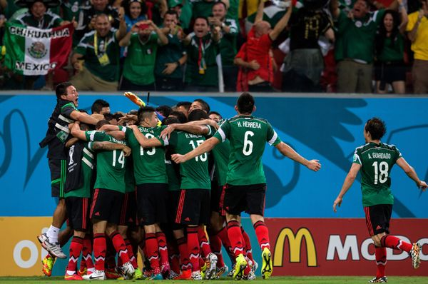 RECIFE, BRAZIL - JUNE 23:  Rafael Marquez of Mexico celebrates with teammates scoring his team's first goal during the 2014 F