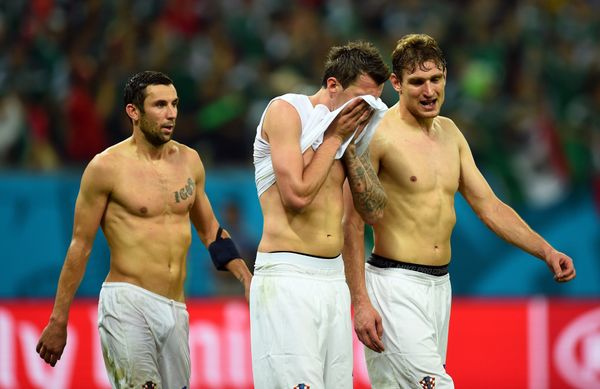 RECIFE, BRAZIL - JUNE 23:  A dejected Mario Mandzukic (center) and Nikica Jelavic of Croatia (R) walk off the pitch after a 3