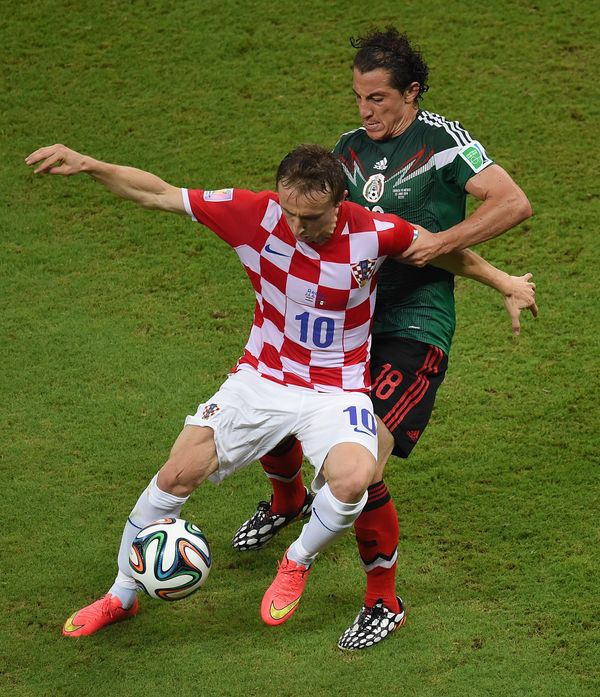 Croatia's midfielder Luka Modric (front) and Mexico's defender Andres Guardado vie for the ball during a Group A football mat