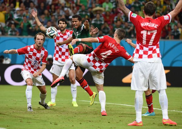 Mexico's forward Giovani Dos Santos (3rd L) attacks the goal of Croatia during a Group A football match between Croatia and M