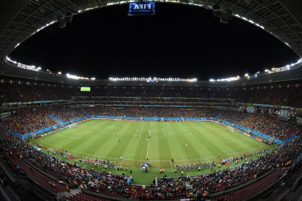 A general view shows players on the field during a Group A football match between Croatia and Mexico at the Pernambuco Arena