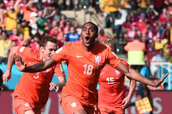 Netherlands' midfielder Leroy Fer celebrates scoring with his teammates during the Group B football match between Netherlands