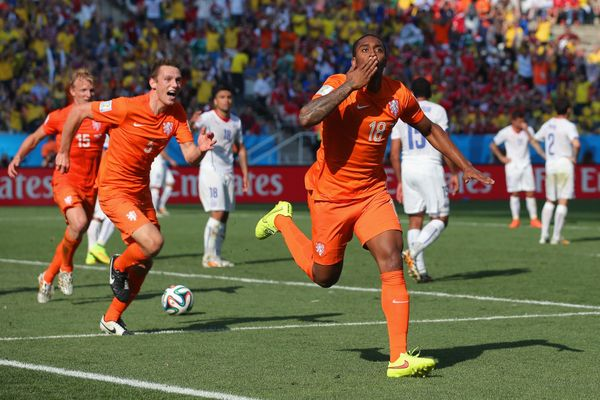 SAO PAULO, BRAZIL - JUNE 23:  Leroy Fer of the Netherlands celebrates scoring his team's first goal during the 2014 FIFA Worl