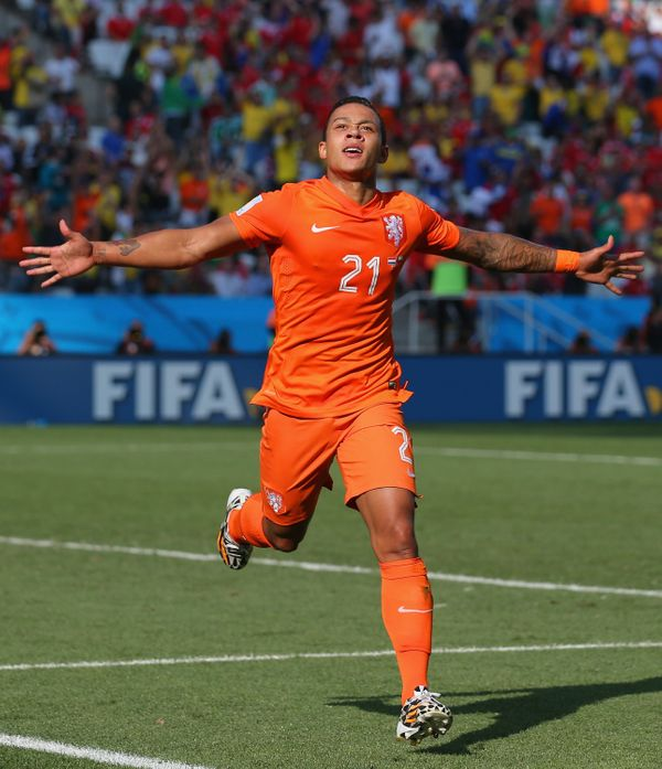 SAO PAULO, BRAZIL - JUNE 23:  Memphis Depay of the Netherlands celebrates scoring his team's second goal during the 2014 FIFA