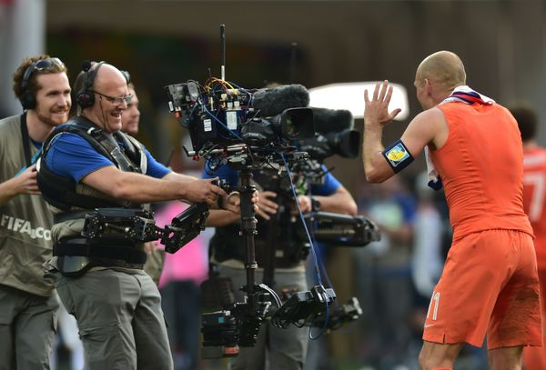 Netherlands' forward Arjen Robben (R) celebrates their victory at the end of during a Group B football match between Netherla