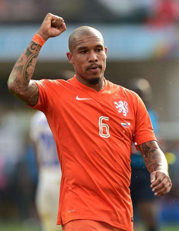 Netherlands' midfielder Nigel de Jong celebrates their victory at the end of a Group B football match between Netherlands and