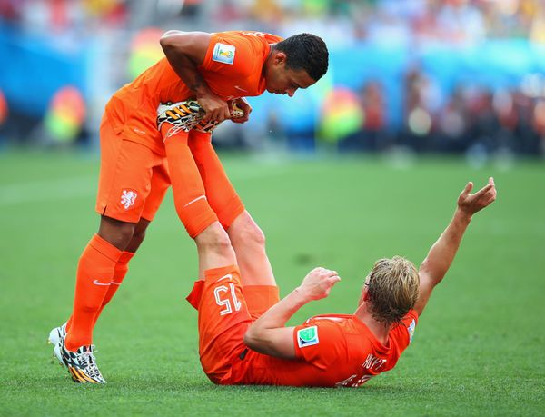 SAO PAULO, BRAZIL - JUNE 23:  Memphis Depay of the Netherlands helps Dirk Kuyt stretch during the 2014 FIFA World Cup Brazil
