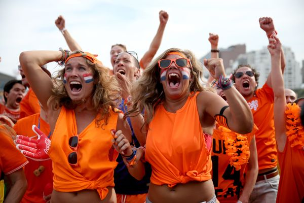 RIO DE JANEIRO, BRAZIL - JUNE 23:  Netherland soccer fans react as their team scores their second goal against Chile as they