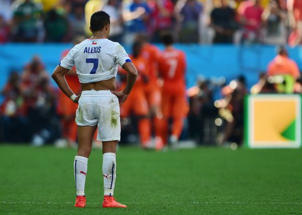 Chile's forward Alexis Sanchez reacts after a Group B football match between Netherlands and Chile at the Corinthians Arena i