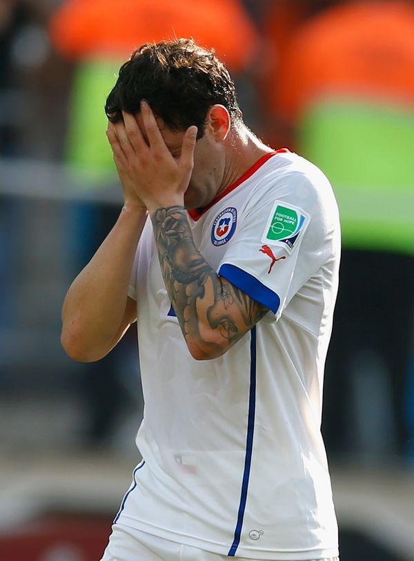 SAO PAULO, BRAZIL - JUNE 23:  Eugenio Mena of Chile reacts after a 2-0 defeat to the Netherlands in the 2014 FIFA World Cup B