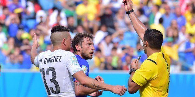 Mexican referee Marco Antonio Rodriguez Moreno (R) shows the red card to Italy's midfielder Claudio Marchisio (C) during the