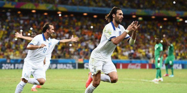 FORTALEZA, BRAZIL - JUNE 24:  Giorgos Samaras of Greece celebrates scoring his team's second goal on a penalty kick during th