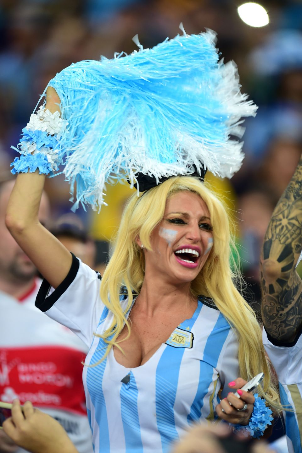 A Argentina fan cheers on her side in the stands