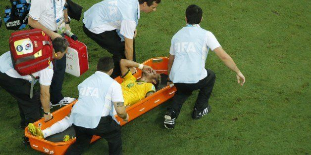 Brazil's forward Neymar is carried on a stretcher after being injured during the quarter-final football match between Brazil