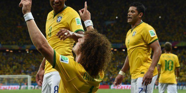 Brazil's defender David Luiz (C) celebrates scoring during the quarter-final football match between Brazil and Colombia at th