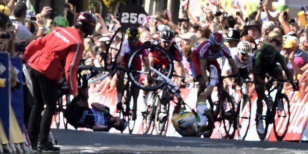 Australia's Simon Gerrans and Britain's Mark Cavendish fall near the finish line at the end of the 190.5 km first stage of th