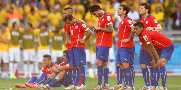 BELO HORIZONTE, BRAZIL - JUNE 28:  Chile players look on preparing for penalty kicks during the 2014 FIFA World Cup Brazil ro