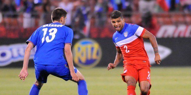 US men's national team player DeAndre Yedlin (R) controls the ball during a World Cup preparation match against Azerbaijan at