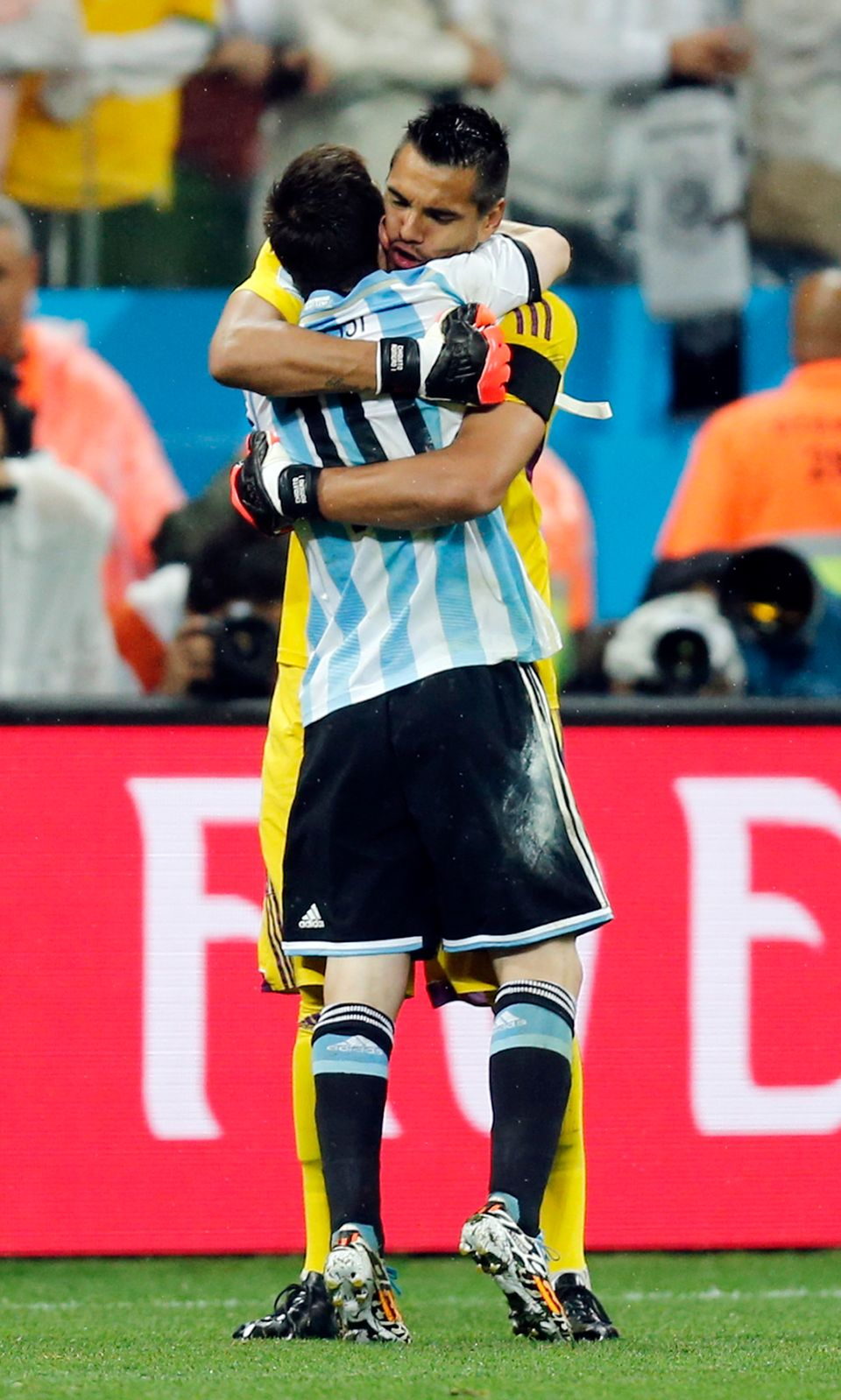 Argentina's Lionel Messi hugs goalkeeper Sergio Romero during the shoot-out of the World Cup semifinal soccer match between t