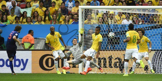 Netherlands' defender Daley Blind (L) scores during the third place play-off football match between Brazil and Netherlands du