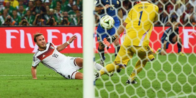 RIO DE JANEIRO, BRAZIL - JULY 13:  Mario Goetze of Germany scores his team's first goal past Sergio Romero of Argentina in ex