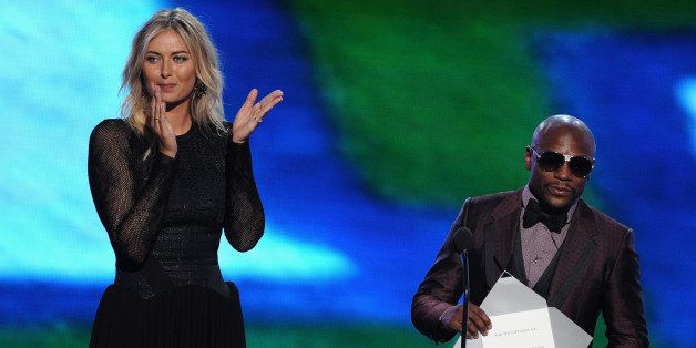 LOS ANGELES, CA - JULY 16:  Tennis player Maria Sharapova and boxer Floyd Mayweather Jr. speak onstage during the 2014 ESPYS