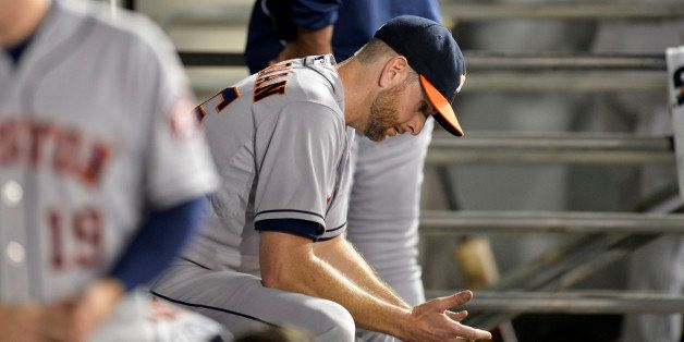 CHICAGO, IL - JULY 18:  Starting pitcher Scott Feldman #46 of the Houston Astros sits in the dugout after the seventh inning