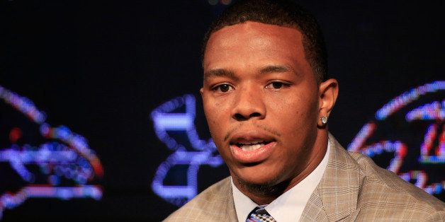 OWINGS MILLS, MD - MAY 23:  Running back Ray Rice of the Baltimore Ravens addresses a news conference with his wife Janay (no