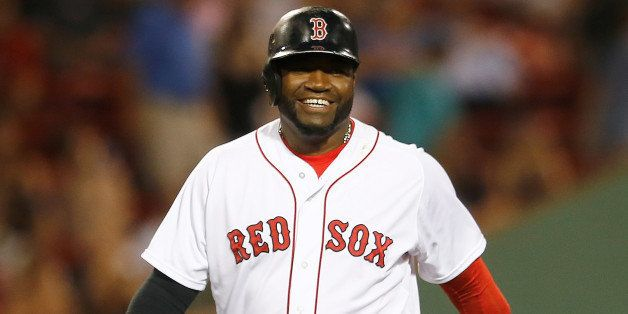 BOSTON, MA - JULY 1: David Ortiz #34 of the Boston Red Sox smiles as he leaves the field in the seventh inning against the Ch