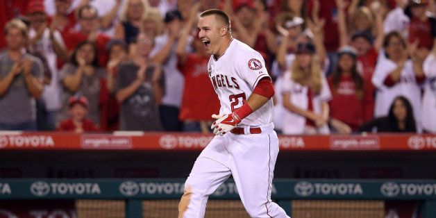 ANAHEIM, CA - JULY 04:  Mike Trout #27 of the Los Angeles Angels of Anaheim celebrates as he runs home after hitting a game w