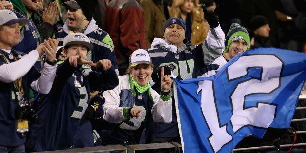 EAST RUTHERFORD, NJ - FEBRUARY 02: Seattle fans hold a '12th Man' flag during Super Bowl XLVIII at MetLife Stadium on Februar