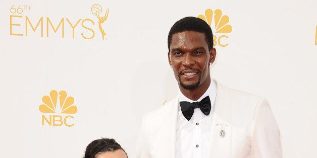 LOS ANGELES, CA - AUGUST 25:  NBA player Chris Bosh (R) and wife Adrienne Bosh attend the 66th annual Primetime Emmy Awards a