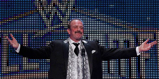 "IMAGE DISTRIBUTED FOR WWE - Jake ""The Snake"" Roberts speaks during the WWE Hall of Fame Induction at the Smoothie King Center"