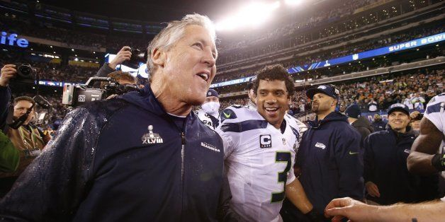 Seattle Seahawks head coach Pete Carroll and quarterback Russell Wilson celebrate after a 43-8 victory against the Denver Bro