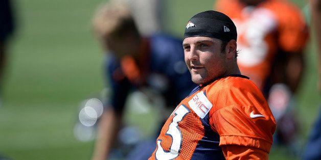 ENGLEWOOD, CO - JULY 25: Denver Broncos wide receiver Wes Welker (83) stretches during day two of the Denver Broncos 2014 tra