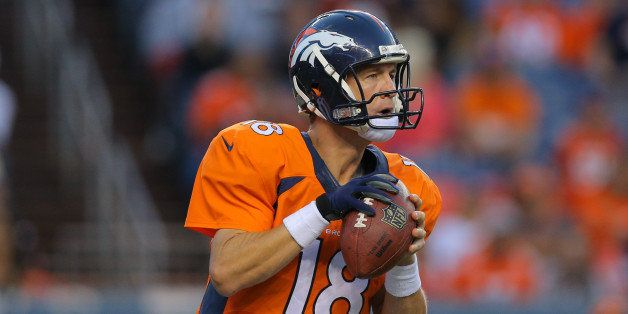 DENVER, CO - AUGUST 23:  Quarterback Peyton Manning #18 of the Denver Broncos in action against the Houston Texans during a p