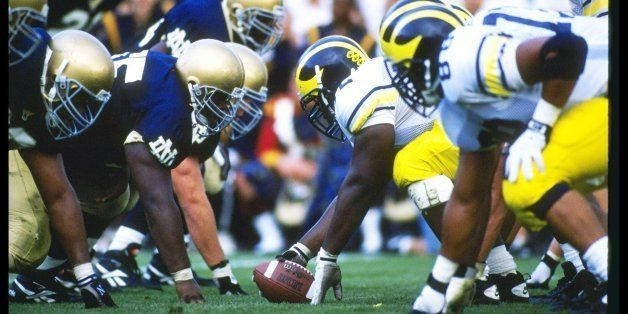 10 Sep 1994:  Center Rod Payne of the Michigan Wolverines prepares to snap the ball during a game against the Notre Dame Figh