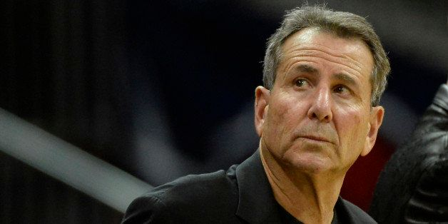 Atlanta Hawks co-owner Bruce Levenson watches from his courtside seat in the second half of their NBA basketball game against