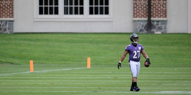 Baltimore Ravens running back Ray Rice walks on the field during NFL football minicamp, Thursday, June 19, 2014, at the team'