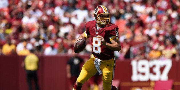 LANDOVER, MD - SEPTEMBER 14: Quarterback Kirk Cousins #8 of the Washington Redskins rolls out during a game against the Jacks